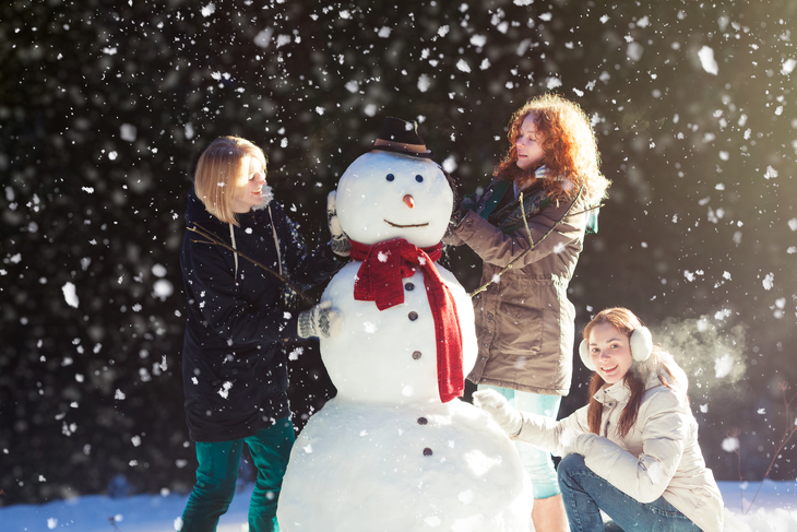 A snowman-building competition is a great holiday fundraising idea for schools.